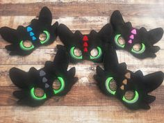 You are picking the color in the middle of Toothless for the triangles They are machine embroidered on felt. Fits children approx 3 and up. Perfect for