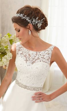 Obsessed with the gorgeous lace detail and embellished waist. #wedding #dress