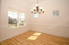 The Biltmore dining room with hardwood laminate flooring. Built by Mckee Homes.