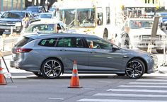 View 2018 Buick Regal Sedan and Wagon Spied: They're Undisguised and They're Hot Photos from Car and Driver. Find high-resolution car images in our photo-gallery archive.