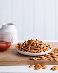 These Sriracha-flavored pumpkin seeds are made with just a few ingredients and are a terrific snack.