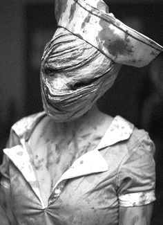 .... crazy nurse from silent hill. Awesome costume. She could be the door greeter.