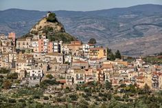 "Enna is a city and comune located roughly at the center of Sicily, southern Italy, in the province of Enna, towering above the surrounding countryside. It has earned the nicknames ""belvedere"" (panoramic viewpoint) and ""ombelico"" (navel) of Sicily."