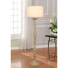 Add a touch of light to your indoor space with this table lamp. A cream shade completes this stylish lamp.