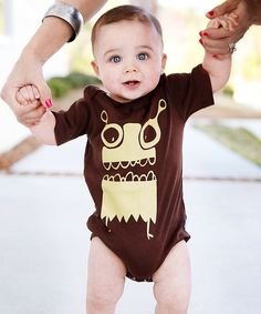 From the front to the back, this bitty bodysuit's silly graphics will keep little ones and every passerby in joyful spirits. A lap neck and bottom snaps are just the ticket for an easy on and off.100% cottonMachine wash; tumble dryImported