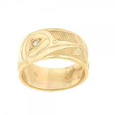Love, Harmony, Beauty & Intelligence the perfect meaning for a wedding band. This 14K hand carved Humming Bird ring w/ a diamond set in the eye  is unique option. Artist - James McGuire - Haida