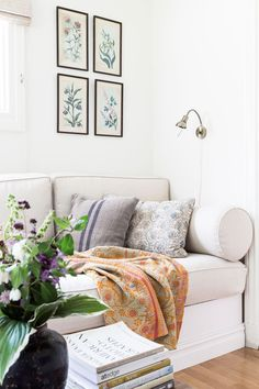 Botanical wall prints are echoed by textile patterns.