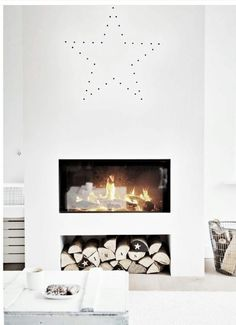 I like the wood storage underneath. This would, of course, be decorative, but perhaps a way to raise the fireplace up?