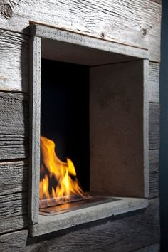 a new fireplace idea and integrating old barn wood into a contemporary home by http://www.eeuwenhout.be