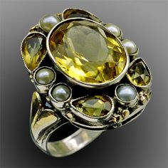 BERNARD INSTONE 1891-1987 Arts & Crafts Ring  Silver, parcel gilt, citrine & pearl Length: 2.3cm  Width: 2cm  English. Circa 1925.