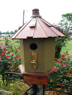 Woodland Bird House Outdoor Home and Garden wooden painted moss color with wooden shake roof. $90.00, via Etsy.
