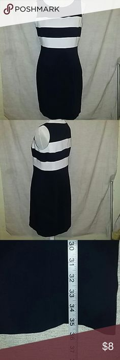 Navy and white dress, Jones New York. This a beautiful navy with white stripes dress. Zips in back, size8 Jones New York. Like new, sleeveless. Jones New York Dresses