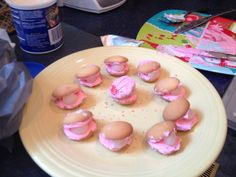 Clam shell cookies= 2 wafers 1 white jellybean pink icing pink sprinkles