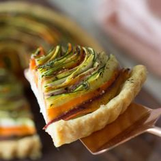 I wanted to make a vegetable tart so I got all my ingredients including tons to beautiful veggies from the market on my shopping day. I was imagining a beautiful composition of eggplant, asparagus, heirloom carrots etc. HOWEVER, when it came to actually make the tart I realized that what I really wanted to make was a mesmerizing spiral tart.. Back to the market I go… This time for some zucchini and yellow summer squash, to accompany the carrots I had. The tart might look crazy and time…