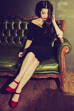 Woman on green sofa. Photo copyright Christie Goodwin, all rights reserved