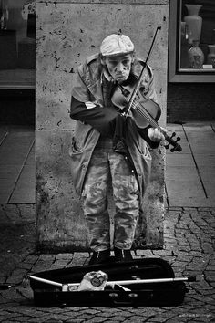 Street Music~ Photo by Frank Schillinger - What what his name? Where was he born? What was his life like before he was here?