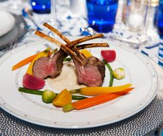 Rack of lamb is beautifully placed with bright seasonal accoutrements.