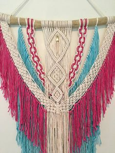 This gorgeous macrame wall hanging is made with cotton twine on a piece of local driftwood. It is dyed with a rich pink and aquamarine blue and is accented with a lovely quartz crystal. It would be the perfect Christmas gift, wedding gift, it would be great in a nursery. The possibilities are endless! It is hand made and ready to ship! Measurements Width of branch 29 Width of macrame 22 Length 35 * when ordering multiple items any shipping overages will be refunded