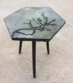Cherry Blossom Table. End table picked up at a second hand store... poured concrete top, cherry blossom painted on with acrylic... sealed with epoxy resin.