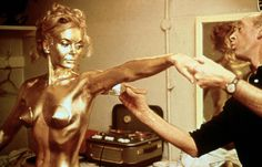 Actress Shirley Eaton being painted gold on the set of Goldfinger in 1964.