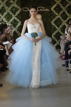 I don't know that I've ever seen blue & white on a bride like this.  I don't know... I don't know.  I want to look some more, I kind of likee.  I don't know. oscar de la renta