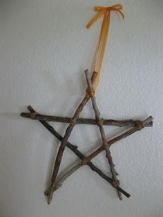Star Ornament. Made this last night from 3 foot bramble sticks i found in the yard. I'm still in the process of wrapping it in wool yarn, but plan on decking it out like a Christmas wall hanging. I've considered hanging ornaments from it's tips....