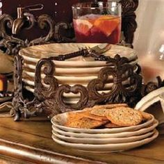 """Gracious Goods 11in Dinner Plate Holder - Brown Metal by The GG Collection. $80.00. Whether you're planning dinner for two; or a buffet for twenty, the Gracious Goods collection of serving ware, casserole dishes, chafing dishes, trays, bowls, salt and pepper shakers, condiment sets and more features everything you will need to set a fabulous table!. Dimensions: Holds 11"""" plates Note: All finishes in this line are handcrafted, resulting in variations of color that reflect ..."""