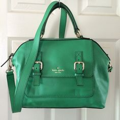 """Kate Spade Allen Street - Raquelle Handbag Kate Spade Allen Street - Raquelle Handbag Color: snappea Material: Leather  Two top handles and optional shoulder strap. Designer logo at front. Front slip pocket with magnetic flap opening and buckle detail. Jacquard """"kate spade new york"""" repeat logo interior lining with a zip pocket and two slip pockets. Top zip closure. Pre-owned: (used for about 2 weeks).  All measurements are approximate: Length: 11½"""" Height: 9"""" Width: 4"""" Drop strap: 5""""…"""