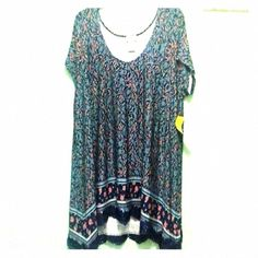 Floral tunic with crochet hem. Loose, flowy short sleeved shirt with crochet detailing on the bottom. Slightly high/low. Wet Seal Tops Tunics