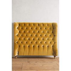 A traditional wingback chair was the inspiration for this stately headboard. It& curved, tufted shape is bound to make quite the historical statement in your… Yellow Headboard, Velvet Tufted Headboard, Velvet Bed, Wingback Headboard, Headboards For Beds, Wingback Chair, Dark Master Bedroom, Anthropologie Furniture, Velvet Furniture