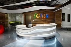 Reception Desk: Corus Entertainment's headquarters in Toronto. Design by Quadrangle Architects and photos by Richard Johnson