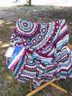 The Queen Mandala won first prize on a county fair.  It is crocheted by Happy Coturnix.  The Queen Mandala Throw pattern can be purchased on http://mandalaqueen.org