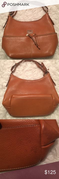"Rooney and Bourke handbag Brown shoulder handbag. Exterior in decent condition. It has light discoloration on the bottom. The inside has pen marks all over it. Please do not purchase if you are not okay with the condition. One zippered pocket on the inside as well as an open pocket. Bag measures L (12"")x W(5"")x H(9""). No holds, no TRADES or lowball offers. Selling for my mom so please be nice ☺️ Dooney & Bourke Bags Shoulder Bags"