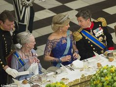 Enjoying a chat: Queen Maxima and Crown Prince Frederik exchange notes during the dinner...