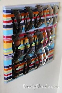 Sunglass storage - ribbons wrapped around a canvas. I don't have enough sunglasses to need this but I like the idea