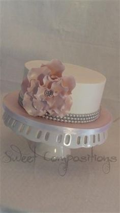 Buttercream with gumpaste ruffle flower and painted silver bead border Pink Ruffle Cake, Fondant Ruffles, Gorgeous Cakes, Pretty Cakes, Amazing Cakes, Single Layer Cakes, Baby Girl Cakes, Bridal Shower Flowers, Sugar Craft