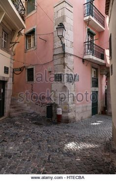Narrow streets of Alfama, Lisbon, Portugal - Stock Image