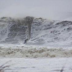 Daredevil during Hurricane Sandy surfing in Ocean City Maryland