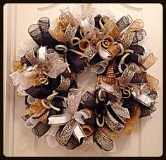 This Elegant black, gold and white deco mesh wreath will look great for Christmas time and year round in your home.    The black, gold and white