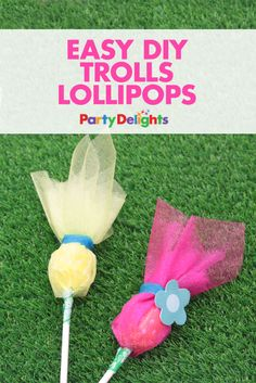 These Trolls lollipops are a super easy party favour idea! All you need is some brightly coloured organza to turn ordinary lollipops into these cute Trolls party favours - perfect for fans of the movie!