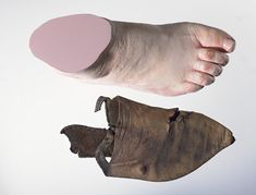 Leather shoe and replica foot: late 14th century 1360-1400 AD good shape of shoe
