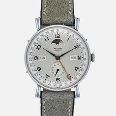 Why This Watch Matters It's not often you find a triple calendar watch in Norwegian, but we found a great one for you by Record. The Full Story Record watch manufacture was founded in 1903 and purchased by Longines in 1963. They produced a finite range of watches including this triple calendar moon-phase steel watch in Norwegian. The case is aerodynamic and lightweight, with flared and fluted lugs. The silvered dial displays the moon-phase, day, month, subsidiary seconds, and date perfectly…