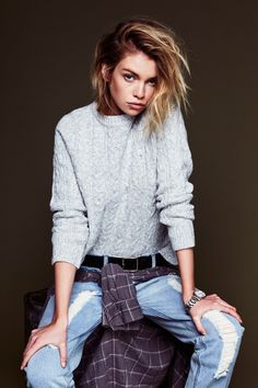 Grunge: Cable knit sweater, distressed jeans, plaid shirt and piercings. Via Know your rights
