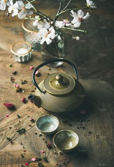 iron teapot cups dried rose candles and almond flowers Traditional Asian tea ceremony arrangement. Golden iron teapot cups dried rose candles and almond blossom flowers over vintage wooden table background selective focus Almond Flower, Almond Blossom, Bougie Rose, Tee Kunst, Asian Tea, Café Chocolate, Rose Candle, Tea Culture, Japanese Tea Ceremony