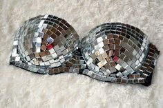 Have a ball - mirrored bra. Could make it myself by cutting up/breaking old CDs and hot gluing them on (I think)
