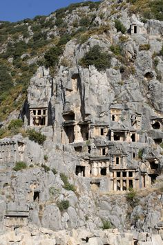 Lycian rock-cut tombs in the form of temple fronts carved into the vertical faces of cliffs at Myra, Turkey. via 500px