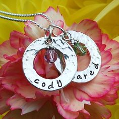 I would love this necklace with my kids names and birthstone bead.