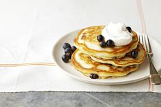 These light and fluffy pancakes are bursting with delicious blueberries!
