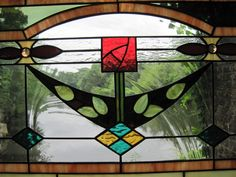 Stained Glass Arts and Crafts MacIntosh Rose Window Panel. $375.00, via Etsy.