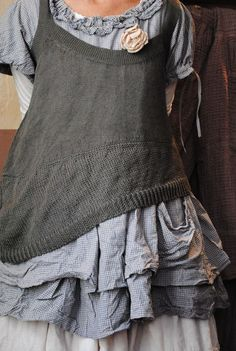 I have a top like this sweater tank that I LOVE; should make some like this guy from old sweaters I don't wear...